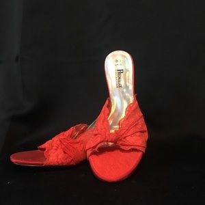 Red lace slip-ons